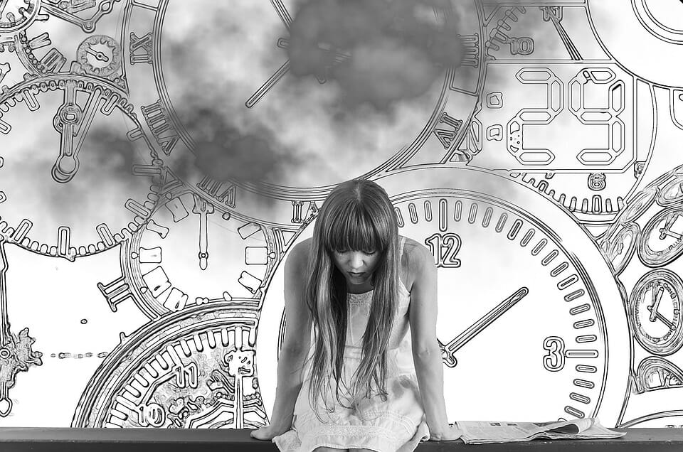 Woman with clocks in the background