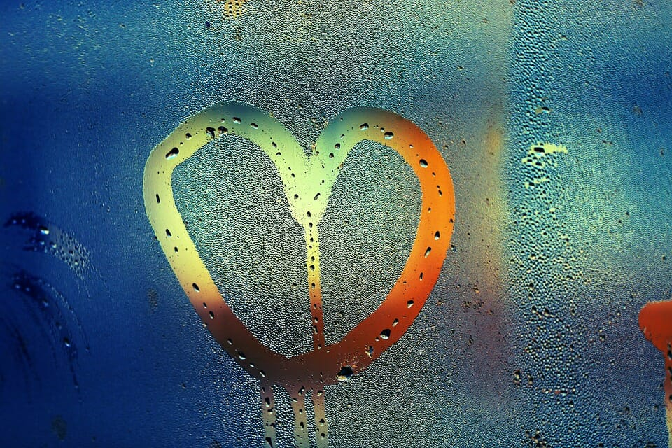 Heart drawn in window moisture