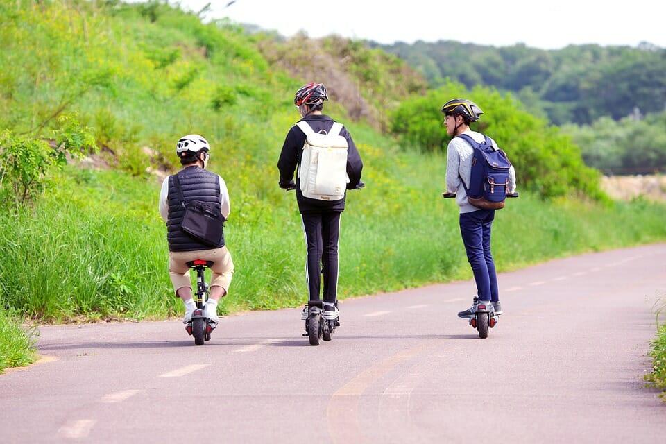 Teenage boys on scooters