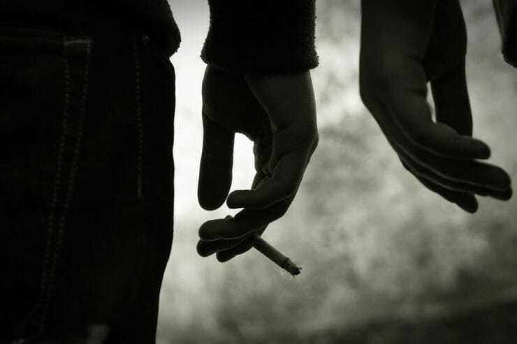 Young people's hands with cigarettes