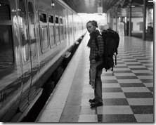 Girl with backpack on a train platform