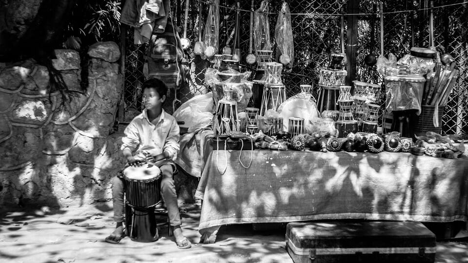 Boy at a drum stall