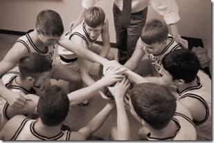 Boys huddling at basketball