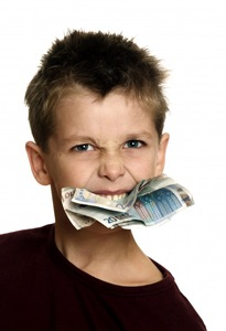 Boy with money notes in his mouth