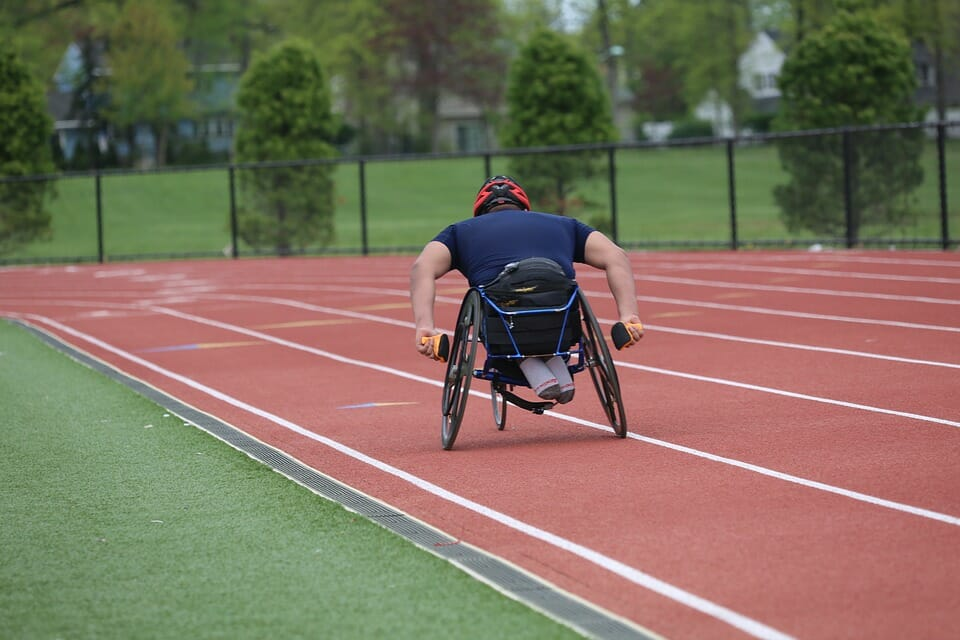 Man in wheelchair on athletics track