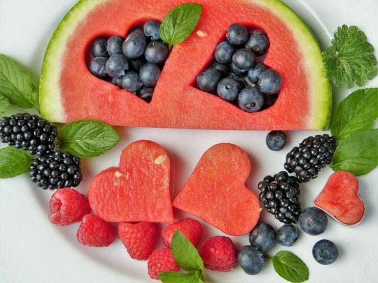 Fruits and mint for detox in heart shapes