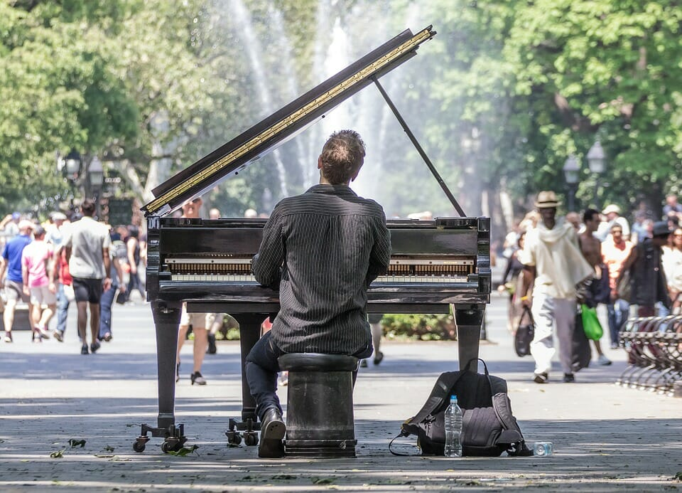 Man playing piano in a park