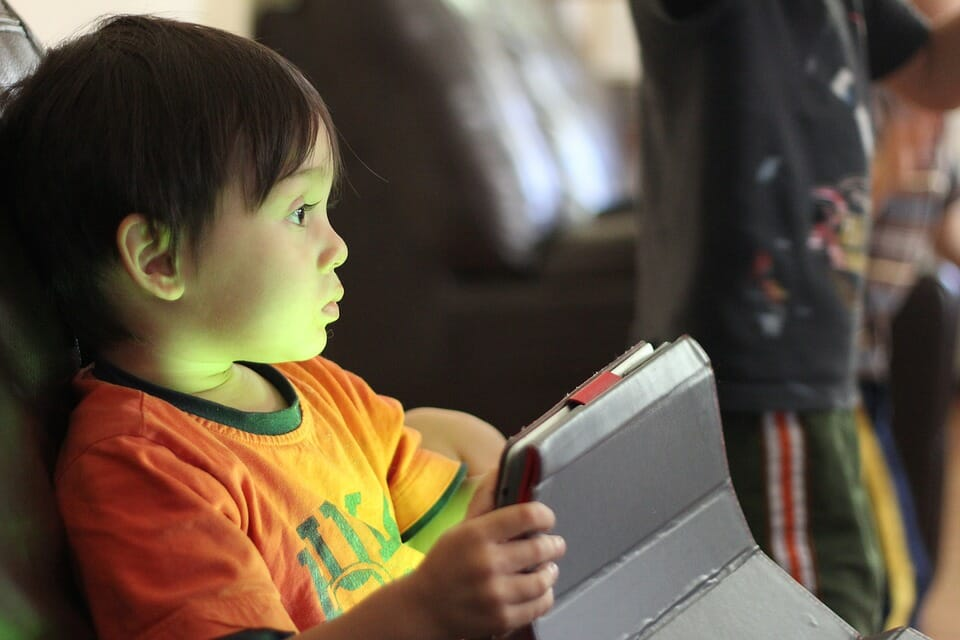 Little boy with a tablet computer