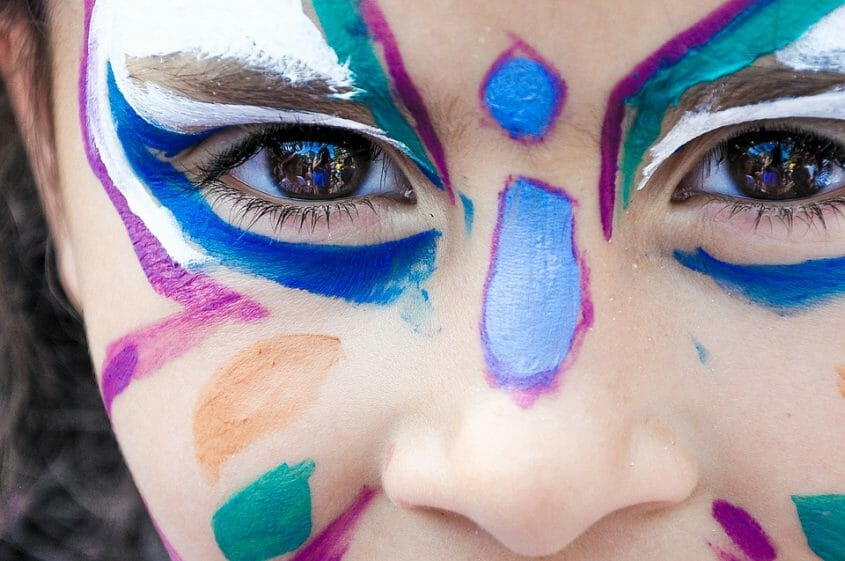 Visual girl with colorful face painting