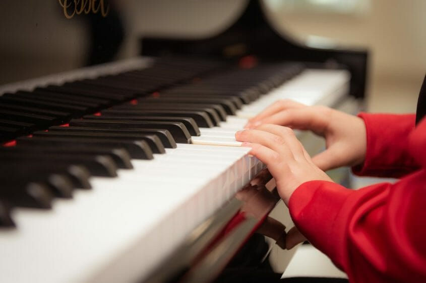 Auditory child's hands playing piano