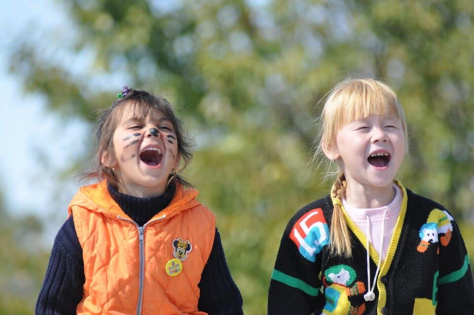 2 girls looking happy