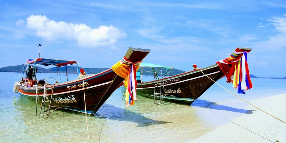 Thai boats on a beach