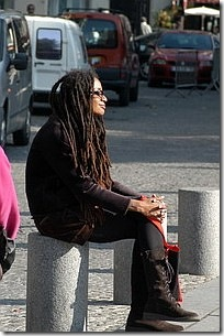 Woman sitting peacefully on the street