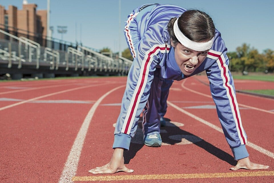 Woman ready to sprint on a track