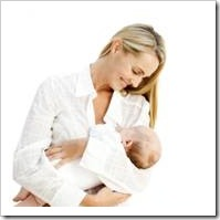 Woman holding baby happily