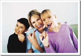 Mother, son and daughter brushing their teeth