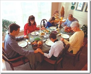 Family saying Grace before a meal