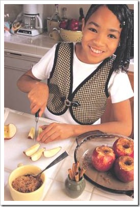 Girl happy cooking in the kitchen