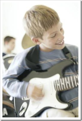 Boy playing electric guitar