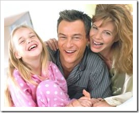 Parents and girl laughing