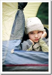 Girl lying down in a tent