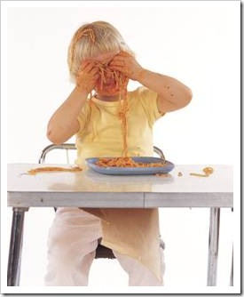 Boy playing with spaghetti