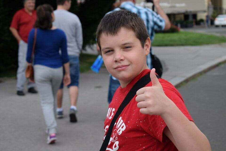 Boy giving thumbs up