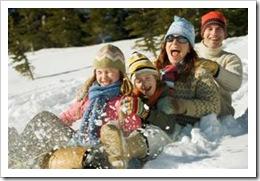 Family snow sledding