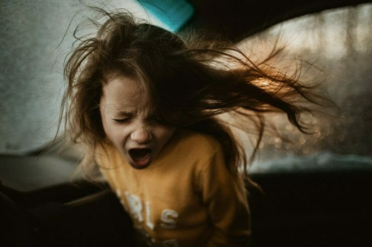 Girl shouting in a car