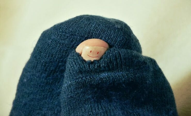 Toe with a smile peeking from socks
