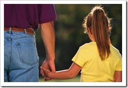 Father and daughter holding hands
