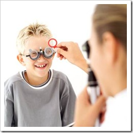 Boy getting his eyes checked