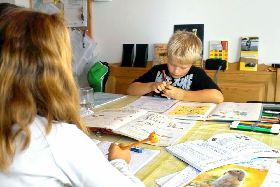 Mother helping boy with homework