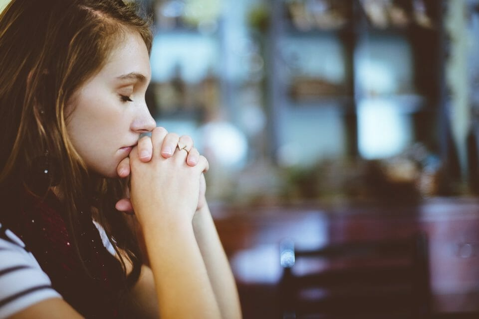 Woman praying to find hope