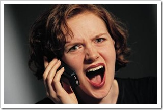 Woman shouting into a mobile phone