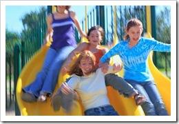 Kids sliding in a playground