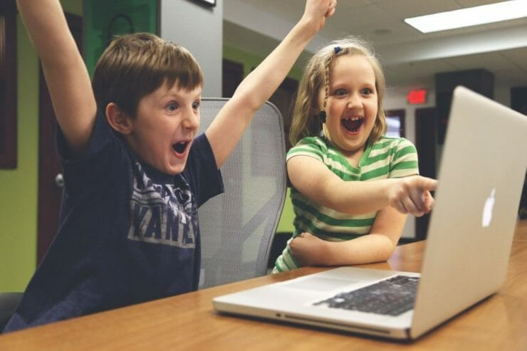 Kids having a success experience at the computer
