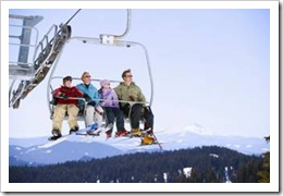 Family with kids in ski lift