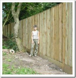 Woman inside a tall fence