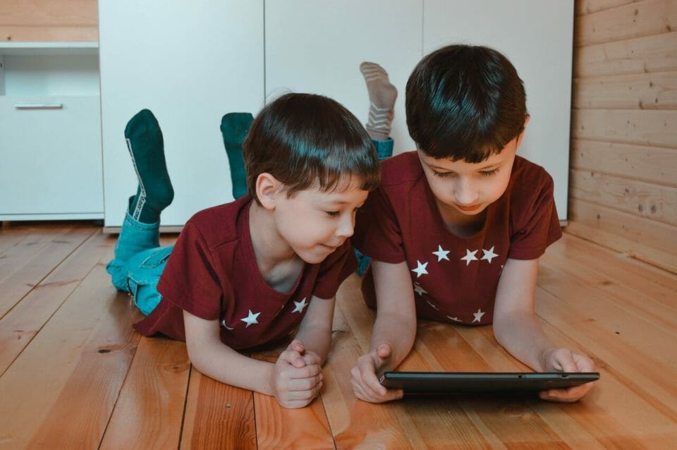 Boys on the floor with a tablet