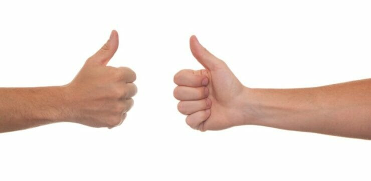 Two hands with thumbs up