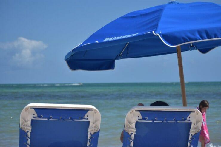 Blue and white beach umbrellas on beach