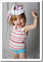 Little girl with underwear on her head and a big smile