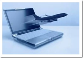 Commercial jet flying out of a laptop