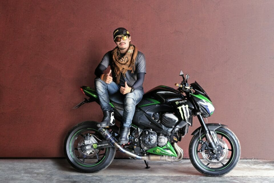 Young man showing off new motorcycle