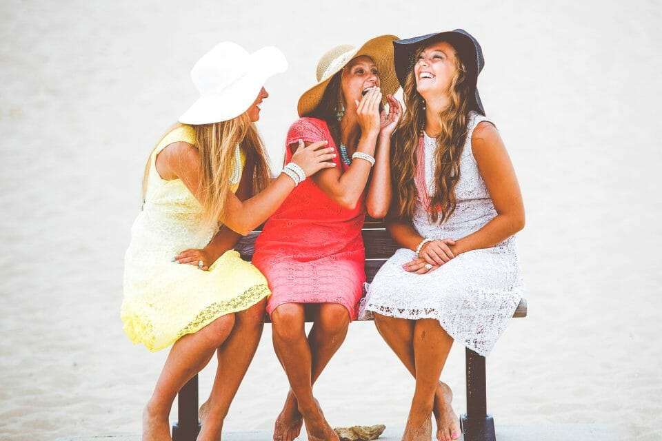 3 young women giggling