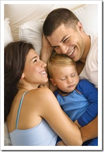 Parents in bed with young child