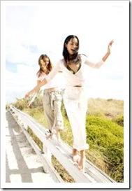 Teen girls balancing on a bridge