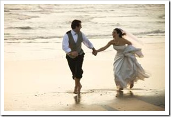 Newly-wed couple on beach
