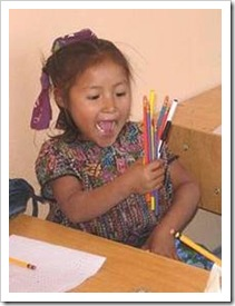 Excited girl with pencils